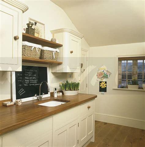 interior of kitchen cabinets image blackboard above sink in wooden worktop in