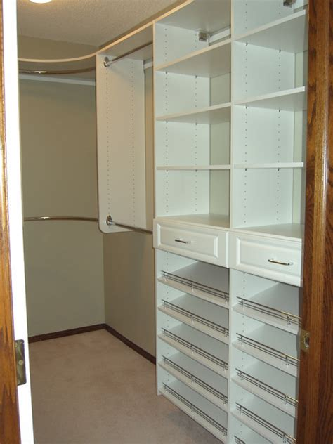 master bedroom closet with shoe shelving on drawer towers