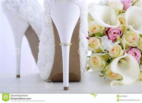 shabby chic wedding shoes wedding ring on beautiful white stiletto shoe heel stock photo image 54129504