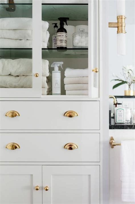 Glass Bathroom Cabinets by Glass Front Bathroom Linen Cabinet With Polished Brass