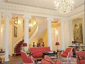 living room with columns and staircase Interior Design