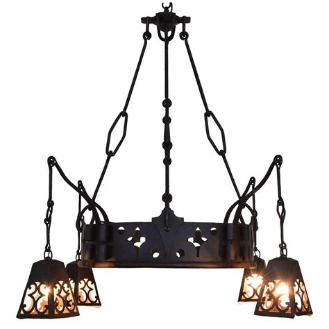 signed wrought cast iron chandelier with hanging lantern