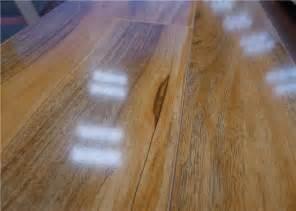 cheap glueless shiny hickory waterproof laminate flooring hdf wooden floating lock of