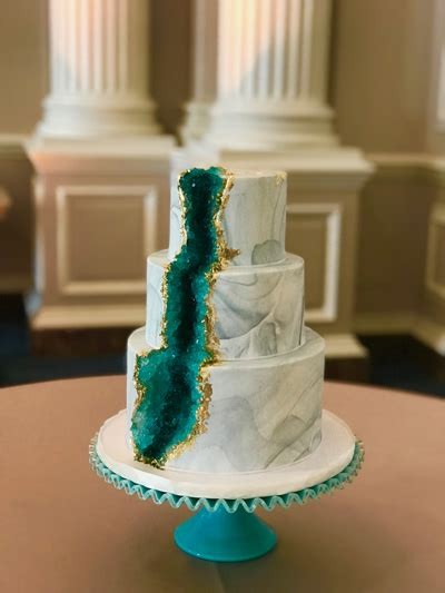 tier marbled cake showcasing  waterfall  geodes