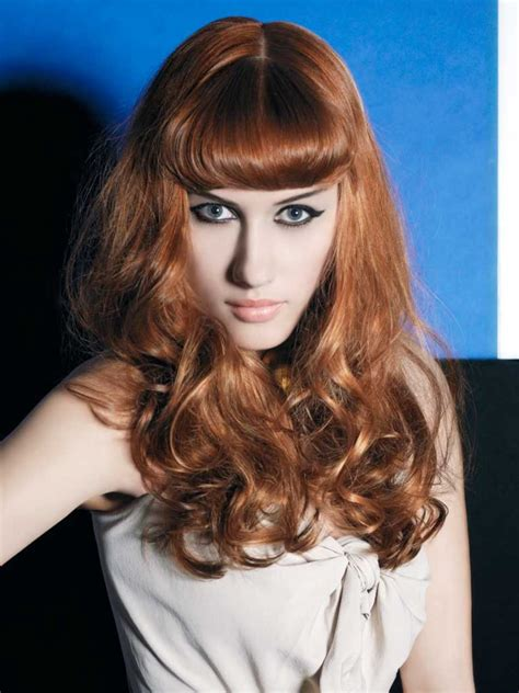 50s style for long hair with the fringe styled inward in a