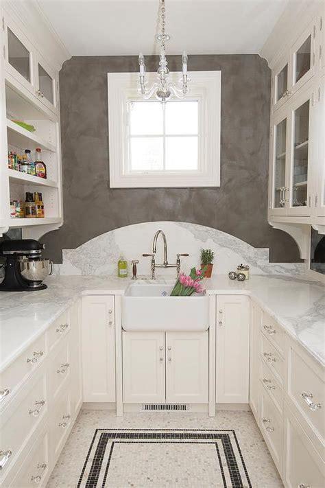mini chandelier  farm pantry sink transitional kitchen