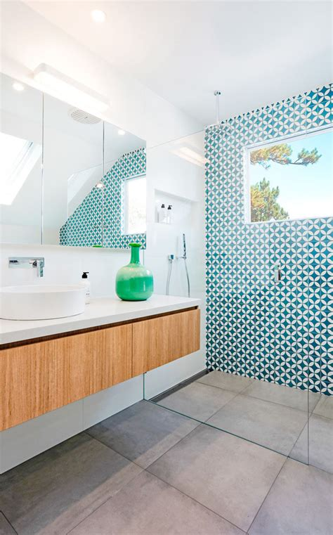 White Bathroom With Color Accents by This White And Wood Bathroom Has A Bright Blue Accent Wall