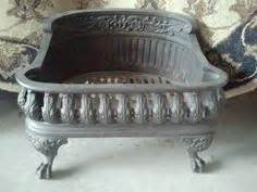 antique cast iron fireplace grate log holder coal box