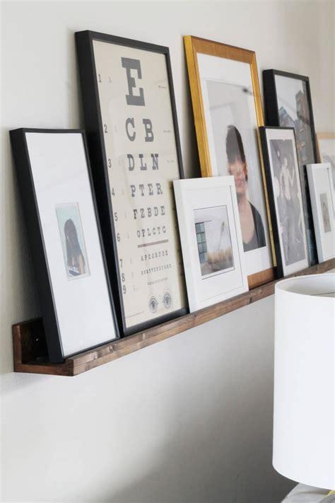 gallery ledge shelves a massive wood picture ledge for the living room chris loves julia