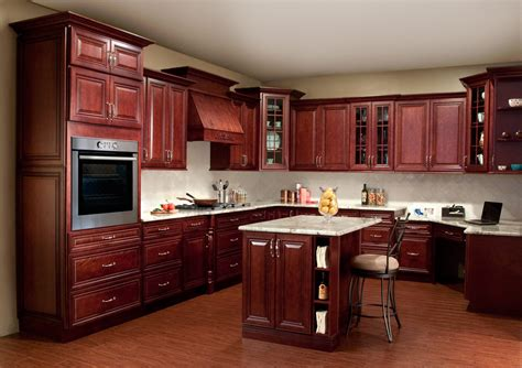 cherry wood cabinets with granite countertop creating a stylish kitchen look using kitchen pain colors