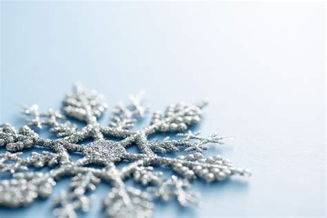 Glitter Snowflake Background by Photo Of Low Angle View Of A Glitter Snowflake Ornament