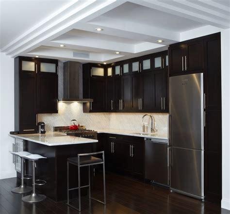 Dark Cherry Cabinets And White Carrara Counter Top