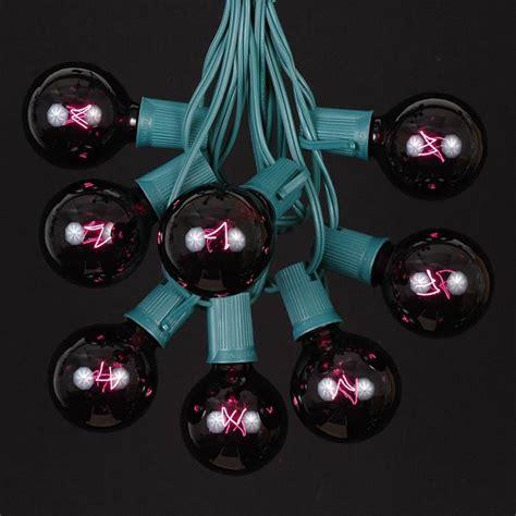 100 black light g50 globe string light set on green wire