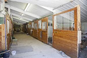 big indoor arena 16 box stalls 4000 sqft living area With covered horse stalls