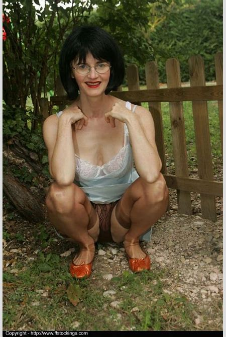 Busty mature lady in stockings doing upskirt and stripping outdoor - PornPics.com