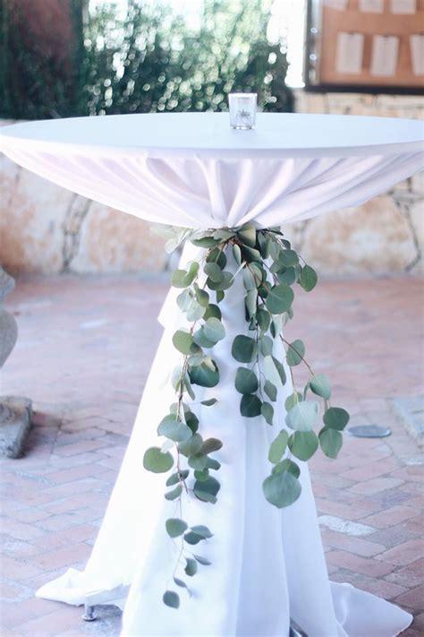 eucalyptus cocktail table ties  wedding table ideas