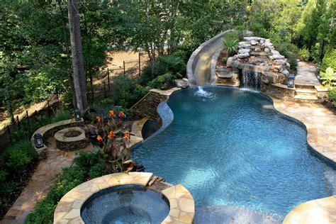 Cave Backyard - pool with slide waterfall grotto cave cave swimming