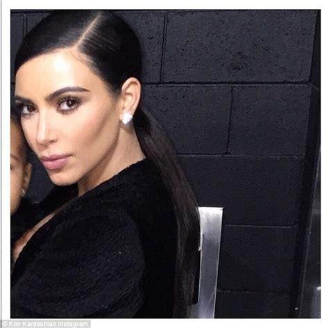 kim kardashian defends cropping daughter north