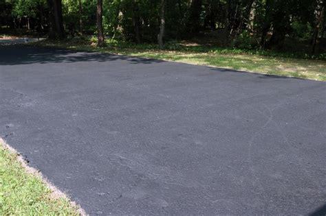 driveway pics how to fix cracks in a driveway and apply a coat of sealant how tos diy
