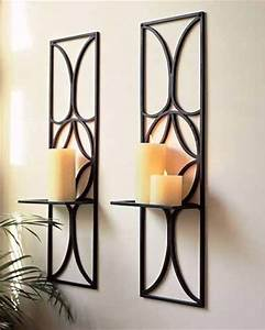 Wall candle holders and candles on