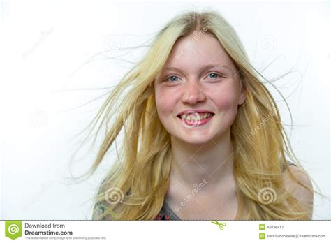 Light Blonde Girl With Long Hair In Wind Stock Photo