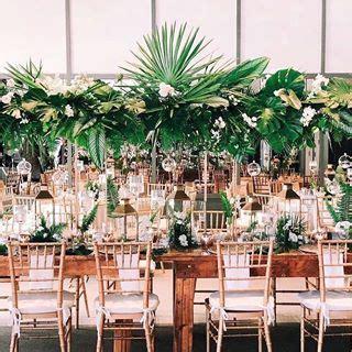Tropical elevated leafy arrangements Palm centerpieces
