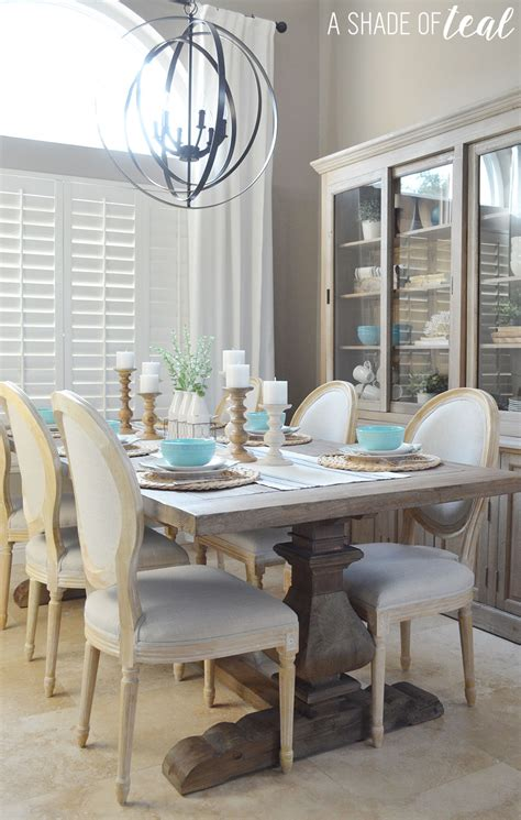 Ladder back chairs with upholstered cream cushion seats give a country chic vibe. Modern Rustic Dining Table Update with Urban Home