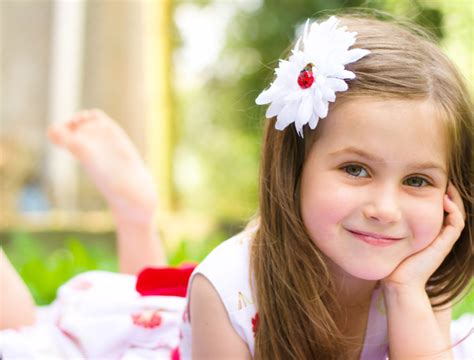 Lying on the grass cute little girl Stock Photo free download
