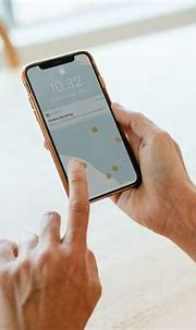 Woman using a mobile phone mockup during coronavirus ...