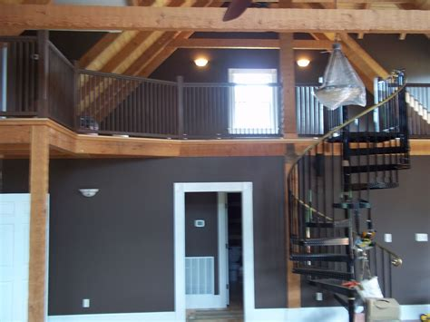 cabin interior great room view of loft wall color