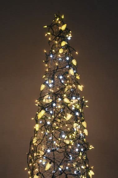 the lighted tree make a christmas tree from a tomato cage