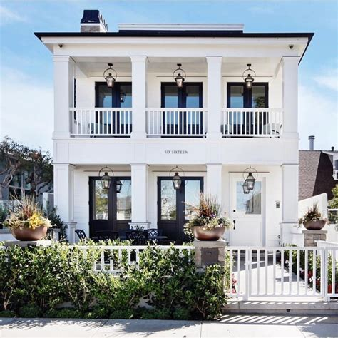 story house double porches lots large windows modern southern style home