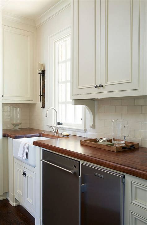 traditional  white kitchen  brick backsplash home