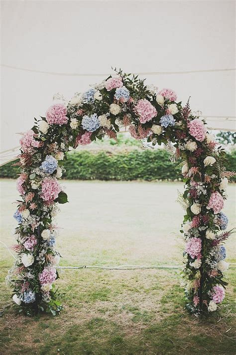 25 Stuning Wedding Arches With Lots Of Flowers Deer