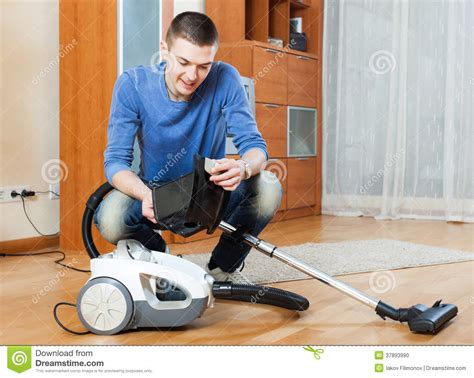 vacuuming floors man vacuuming with vacuum cleaner on parquet floor in living ro stock photo image 37893990