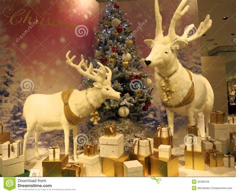 reindeer with xmas tree and presents 2 reindeer pose