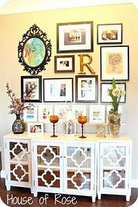 like this cabinet next to piano with wall collage above With kitchen cabinets lowes with wall art collage ideas