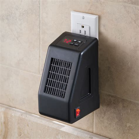 small wall l plug in the wall outlet space heater hammacher schlemmer