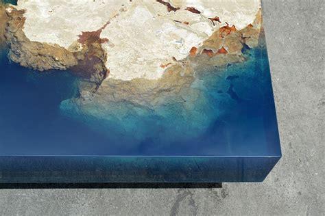 cut stone tables encased  resin mimic  ocean reef