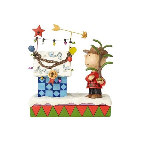 charlie brown  christmas decorated snoopy doghouse