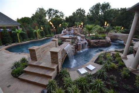 Backyard Pool With Lazy River by Colleyville Residential Lazy River Tropical Pool