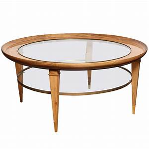 A round two tiered rosewood coffee table with glass top at for 2 tier round coffee table