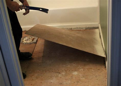 Removing Bathroom Floor Tiles by How To Remove A Tile Floor How Tos Diy