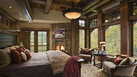 rustic master bedroom  stone fireplace flush light