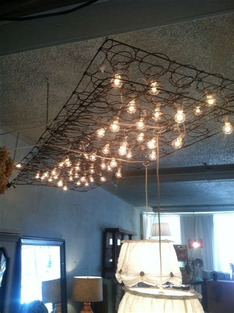 Light fixture made from mattress springs and string lights