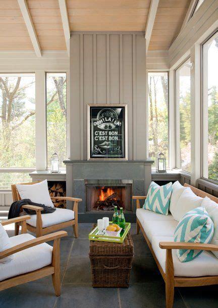 sunroom  gray fireplace teak sofa  chairs slate