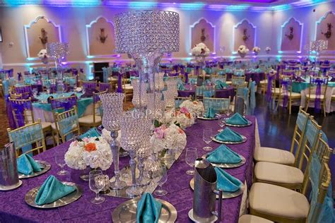 purple and turquoise wedding centerpieces purple