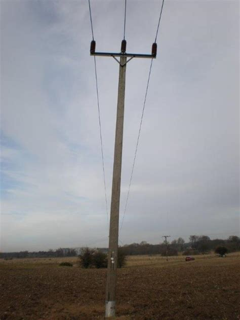 report  leaning electricity pole