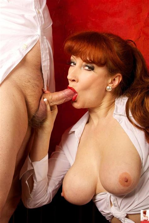 Red Xxx Showing Her Big Boobs As She Sucks A Cock