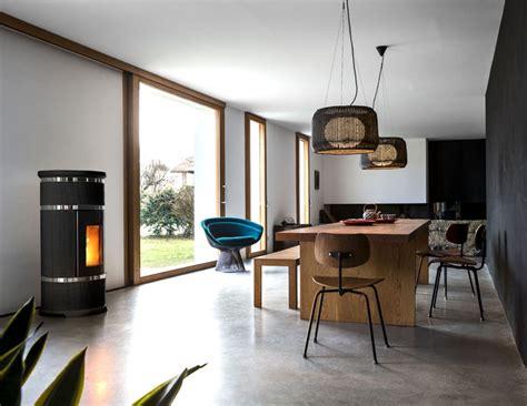 Normale Deckenhöhe Neubau by круглый камин в интерьере дома от компании Mcz